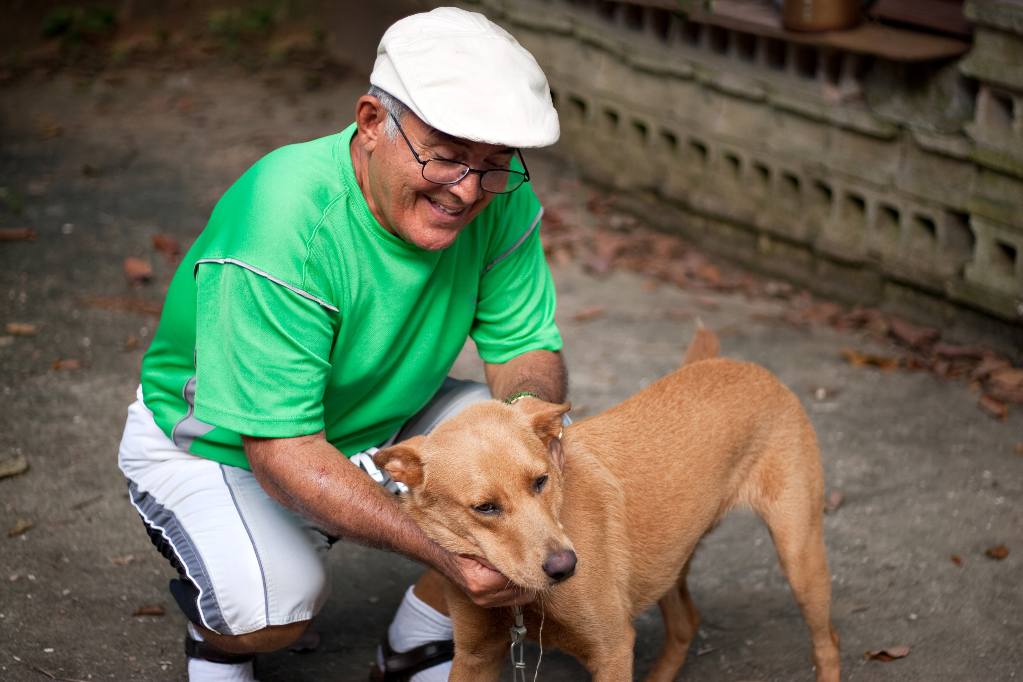an-elderly-hispanic-senior-citizen-man-petting-his-dog-with-a-large-smile-on-his-face_HFceHaNRHs.jpg