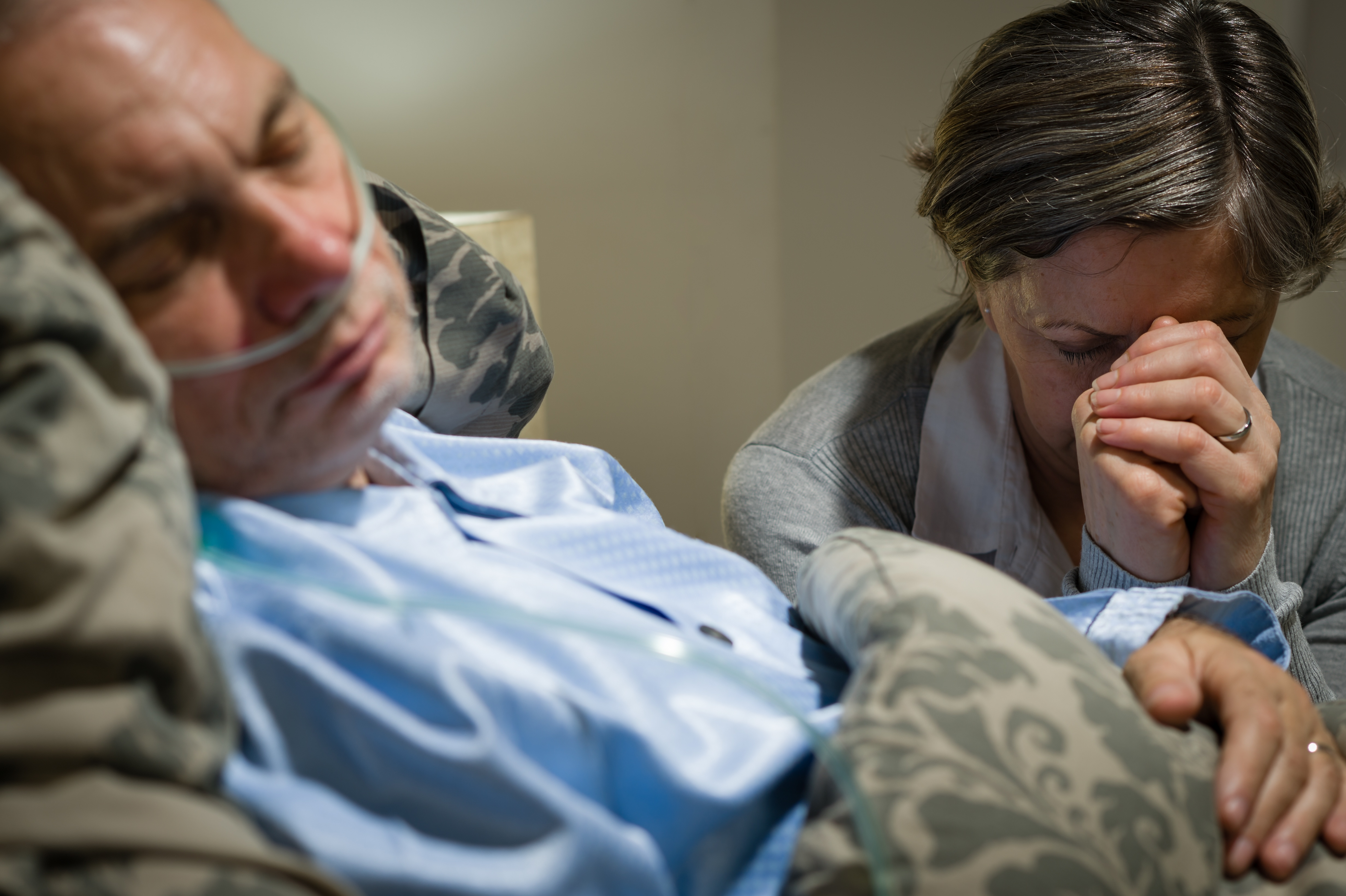 old-wife-praying-for-terminally-ill-husband-lying-in-coma_StBrP7p4i.jpg